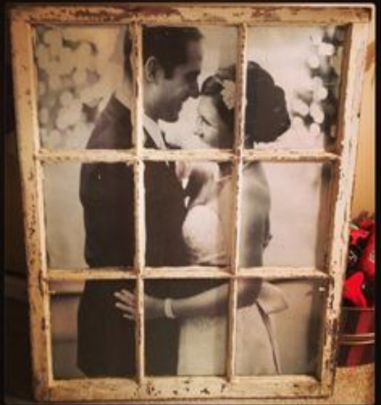 A wooden window frame placed over a 2 dimensional picture