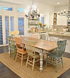 Shabby chic look, table with different styles of chairs